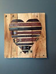 leather belts and pallets 3 year wedding anniversary traditional gift is leather so i made this piece of wall art for my wife as part of her gift