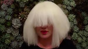 kelly clarkson wigs up for a cover of sia s chandelier