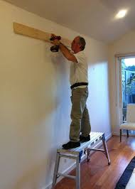 attaching the cleat to timber studs through a plasterboard wall
