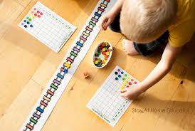 Each turn a player chooses a station to go to and pushes the train around the track to that station. Free Rainbow Train Preschool Counting Game Stay At Home Educator