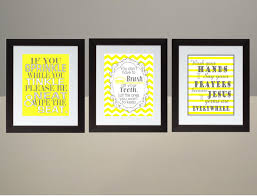 gray and yellow bathroom wall art