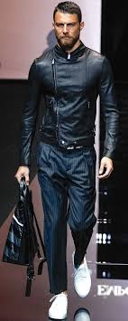 a black leather moto jacket and deep blue striped trousers work together harmoniously round off