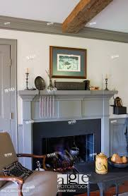 stock photo fireplaces colonial style wood fire fireplaces grey painted fireplace mantel dado and crown molding