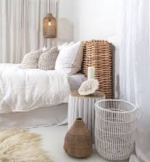 A Wicker Pendant Lamp Echoes With The Same Headboard And Accessories