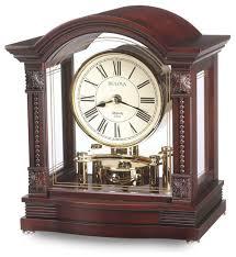 bardwell mantel clock by bulova rotating pendulum wood and glass case