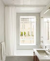straight shower curtain track rod installed with traditional tub shower combo