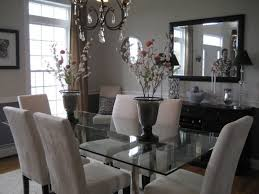soft colors in dining room with contemporary and traditional mix modern gl top table with a traditional chan and credenza
