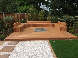 decking area created using yellow balau timber with storage areas and sunken fire pit