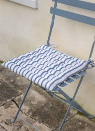 add a nautical stripe to your outdoor furniture with the seat pad in blue stripe cotton