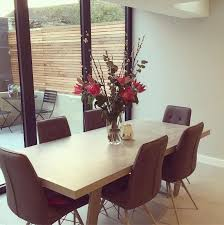 halmstad dining table and 6 hix chairs grey bookcases living room