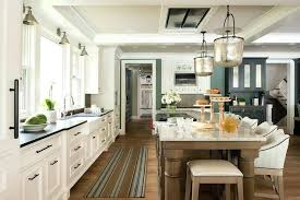 elegant black and white striped runner rug and stunning cottage kitchen features a blue and brown