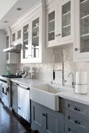 Grey/white kitchen w/ dark wood floors. Farmhouse sink. (Best Kitchen