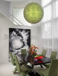 here the green davinci chandelier by schonbek is the focal point for this contemporary dining room
