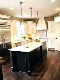 dark wood floors with cream cabinets and island white kitchen cabinet black off