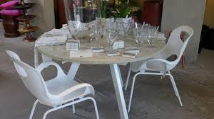 round white concrete dining table with steel base at the gardener in berkeley ca