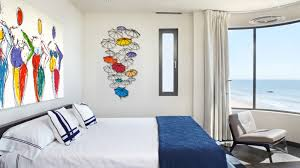 jojo ohayon wall sculpture and painting in a bedroom photo courtesy