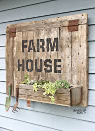 barn door sign planter box with old sign stencils barnwood barndoor repurpose repurposed stencil oldsignstencils farmhousestyle junkgarden