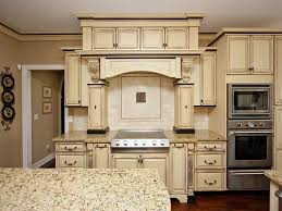 Tuscan Kitchen Using Brown Wall Color And Ivory Distressed Furniture  Cabinets Team Up With Granite Countertops