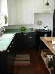 abbey and phil hendrickson transformed their kitchen by painting the cabinets in forest canopy a