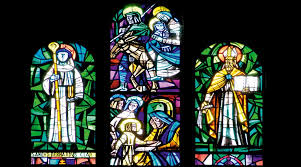 one of the triple lancet windows featuring an episode in the life of mary at the center the flight to egypt and mary discovering christ among the elders