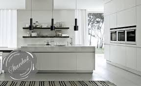modern kitchen counter. Minimal White Modern Bulthaup Kitchen Design With Counter Pendant Lamps Modern-kitchen