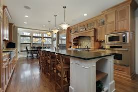 Custom Wood Kitchen With Wood Floor. Cabinets Span Both Sides Of The Room  With A