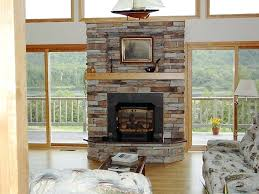 stacked stone fireplace with mantel stone