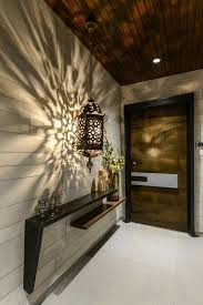 Wonderful idea for a tight entrance or foyer space! Skinny ledge over  another with interesting shadow cast by lamp to break up a long passageway