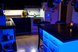 customer installed color chasing dream color led strips around kitchen island to create cool accent lighting and floating effect
