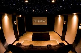 fshionable home theater design idea with brown sofa brown wall and sparkling star light accent of ceiling