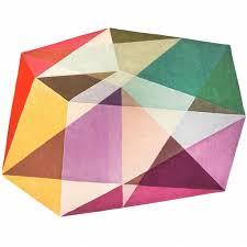a cropped detail image of sonya winner prism pastels area rug showcasing the soft pink