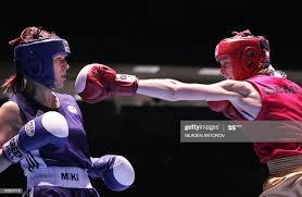 Dina Burger of Sweden fights with Mikhaela Cijevschi of Romania ...