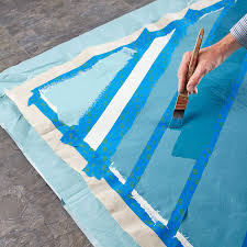 freshen up a porch or patio with a simple weekend painting project turn a drop cloth into a custom colored rug for a touch of outdoor decor