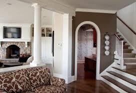 Example of a trendy dark wood floor hallway design in Philadelphia with  brown walls