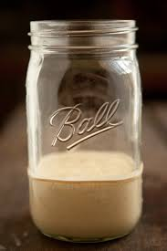 Ball mason jar filled with a wild sourdough starter