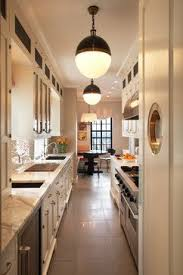 Image kitchen design lighting ideas Light Fixtures Fun Nautical Galley Kitchen With Pendant Lights Pinterest Small Kitchen Lighting Ideas Indoor Living Pinterest Galley