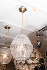 etched glass globe pendant with brass pole and canopy