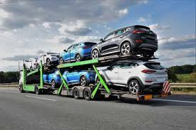 truck carrying cars car