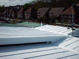 metal roof after encapsulation with liquid waterproofing