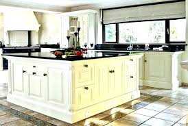white kitchen with brown granite countertops dark granite white cabinets dark granite white cabinets with light