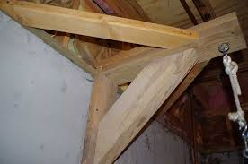 p hanging 70 lb heavybag punching bag from ceiling joists in basement p
