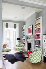 living with add book. the subtle flecks of green on these cosy armchairs bring some playful pattern to this neutral room. while colour co-ordinated books add perfect living with book