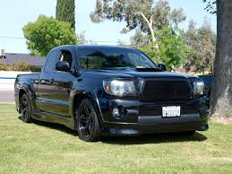 Ohhh... i want one of these. Toyota Tacoma X-Runner, supercharged ...
