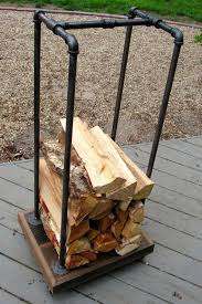 fireplace wood rack recycled pallets and some black pipe firewood holders