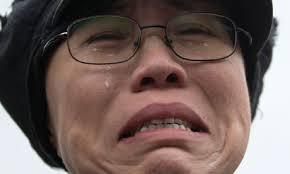Liu Xiaobo's wife, Liu Xia, sobs outside Huairou detention centre where her brother, Liu Hui, is being held. Photograph: Alexander F Yuan/Associated Press - Liu-Xia-wife-of-Chinese-d-008