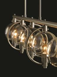 inspirational lighting. Pluto Collection Angular Planes Of Metal Converge Around Glass Globes In This Transitional Family Inspirational Lighting