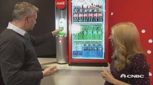 Personal 12 Can Soda Vending Machine Extraordinary Watch CocaCola's New Gadget Turn Sodas Into Slushees In Seconds