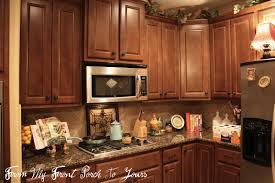 top of cabinet lighting. Here Is Our Kitchen This Evening With Overhead Lighting On And The Lamp Top Of Fridge On. Cabinet