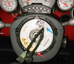 """mini horn repair diy georgeco specr53 blog the horn clock ring officially the """"slip ring"""" is the white component the wires attached the blue arrow shows where the horn wire from the steering"""