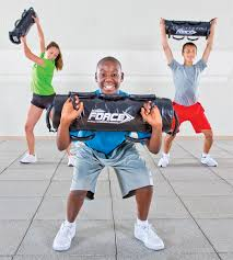kids lifting weighted sandbags primed to be tough with a pvc cover triple sched seams and a shape rening core